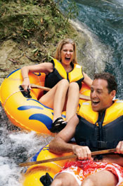A couple vacationing and tube rafting